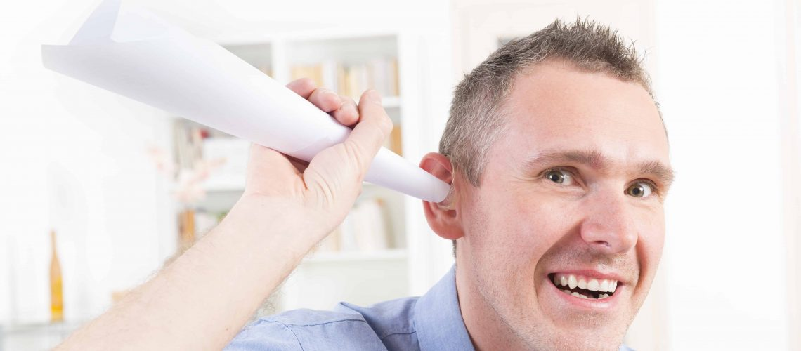 Man joking about hearing loss cure